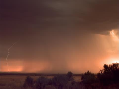 timelapse high desert rainstorm - arid stock videos & royalty-free footage