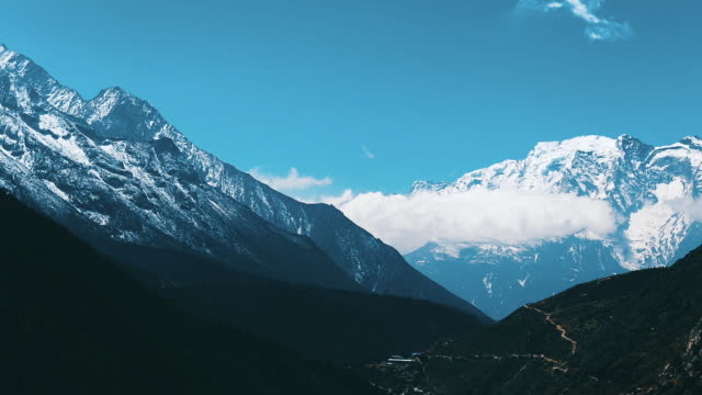 timelapse himalayas mountain range near namche bazaar village at everest region - nepali flag stock videos & royalty-free footage