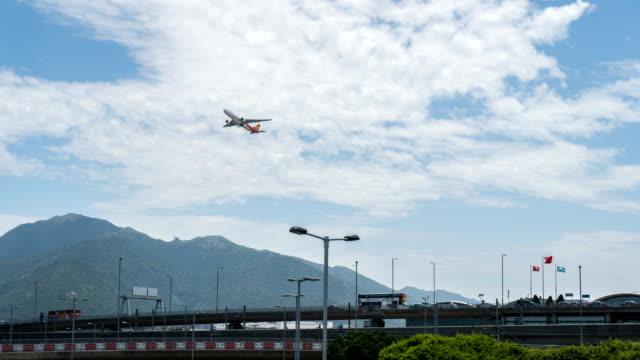 4k timelapse - hong kong airport traffic - hong kong international airport stock videos and b-roll footage