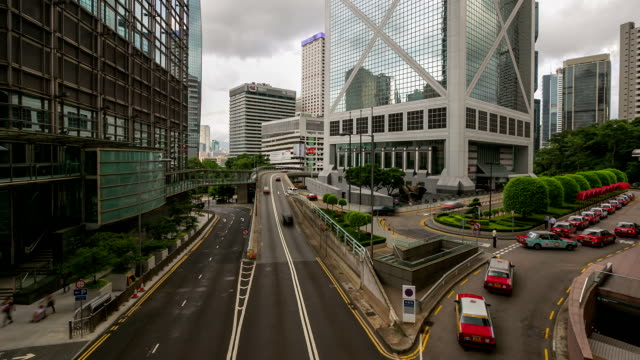 hd time-lapse: hong kong skyline cityscape at central - central district hong kong stock videos and b-roll footage