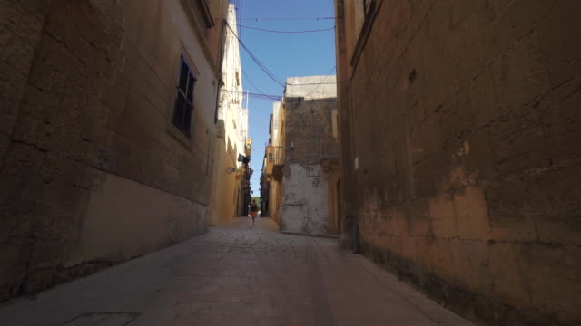 Timelapse, hyperlapse of residential stone street - Malta