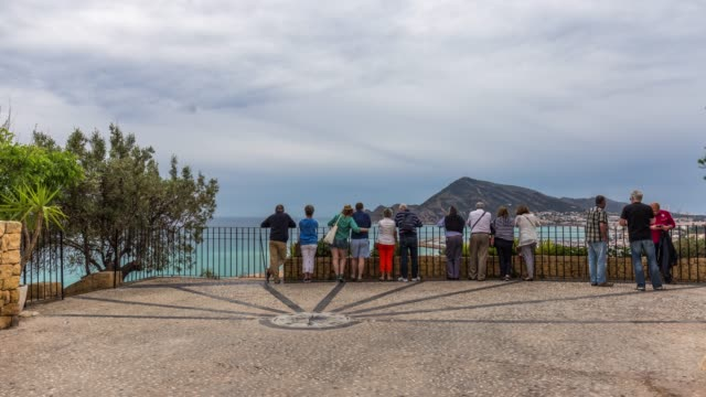Time-lapse if people at mirador of the bay of Altea