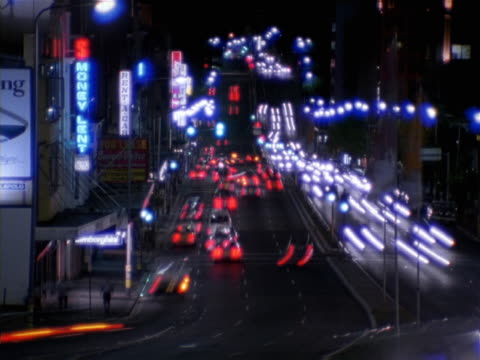 timelapse image of a busy city thoroughfare at night - artbeats 個影片檔及 b 捲影像