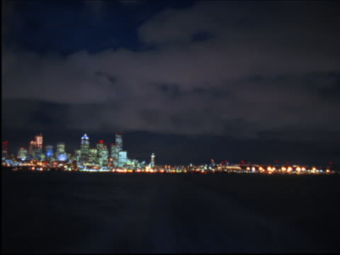 Timelapse image of a night departure from a big city's dock