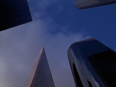 Timelapse image of clouds and four skyscrapers