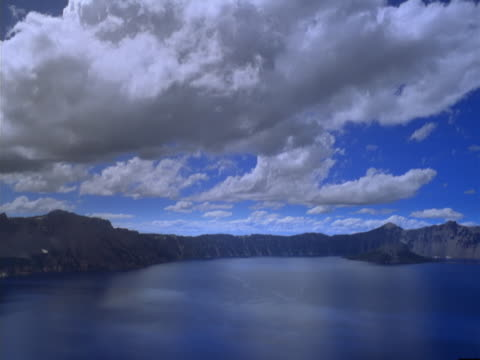 Timelapse image of clouds over crater lake.