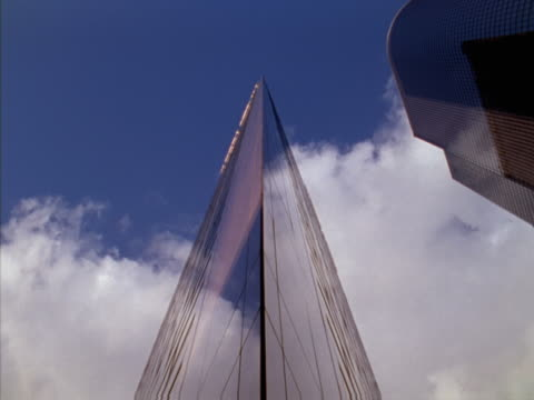 Timelapse image of clouds passing over a wedge-shaped building