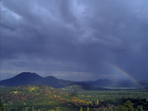 timelapse image of passing rain storm and rainbow. - alm stock-videos und b-roll-filmmaterial