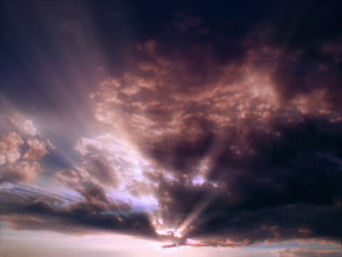 timelapse image of sunbeams through clouds as the sun sets - 20 seconds or greater stock videos & royalty-free footage
