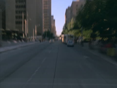 Timelapse image of travel by car through a downtown area.