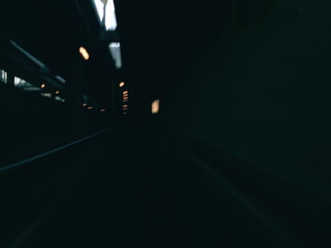 timelapse image of travel by car through a tunnel and onto a freeway. - artbeats 個影片檔及 b 捲影像