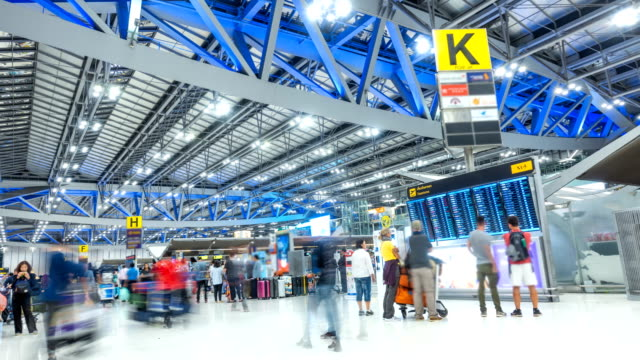 4k t/l timelapse in airport check-in counter and departure board at night - airport check in counter stock videos & royalty-free footage