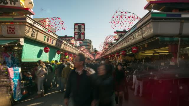 timelapse in tokyo market near sensoji temple - japanese script stock videos & royalty-free footage