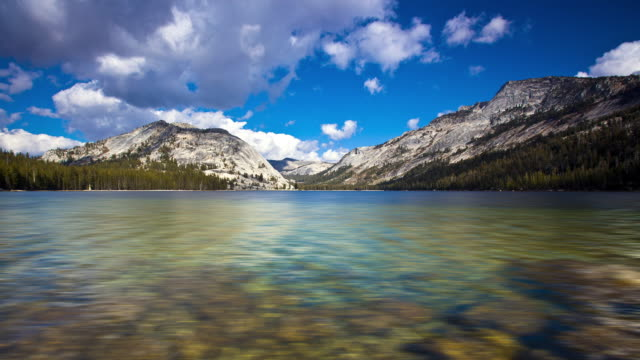 Time-Lapse in Yosemite National Park of clouds rolling over Tenaya Lake near Tuolumne Meadows.