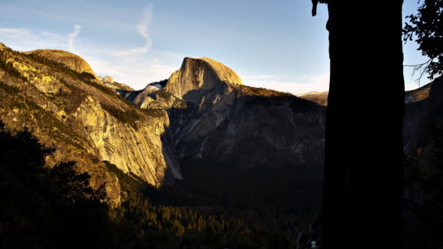 time-lapse in yosemite national park of the last sunlight over half-dome. - yosemite national park stock videos and b-roll footage
