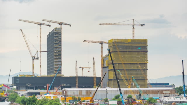 timelapse : infrastructure building cranes construction site working at hong kong - crane stock videos & royalty-free footage