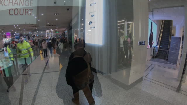 timelapse inside a large shopping mall - customer stock videos & royalty-free footage