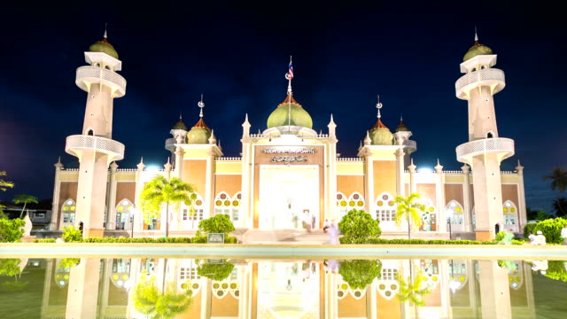 hd time-lapse: islamic prayers walking from central mosque at dusk - dome stock videos & royalty-free footage