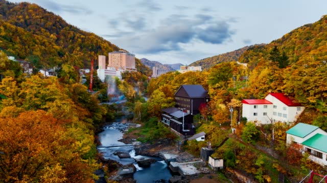 4k time-lapse jozankei onsen town skyline in autumn, hokkaido, japan - japan stock videos & royalty-free footage