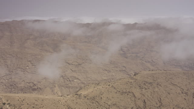 Timelapse Khareef monsoon mist drifts over mountains, Oman
