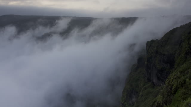 Timelapse Khareef monsoon mist swirls over mountainous coast, Oman