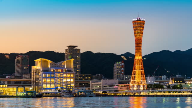 time-lapse: kobe port tower with kobe cityscape in hyogo kansai japan at sunset twilight - tower stock videos & royalty-free footage