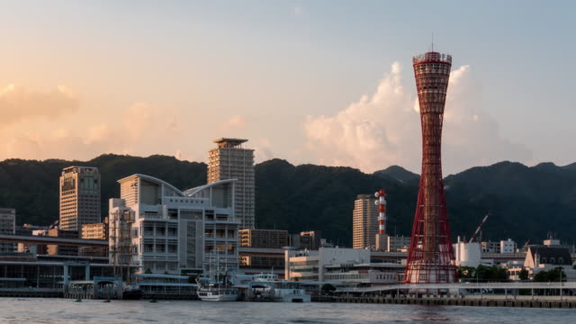 time-lapse: kobe port tower with kobe cityscape in hyogo kansai japan at sunset - tower stock videos & royalty-free footage