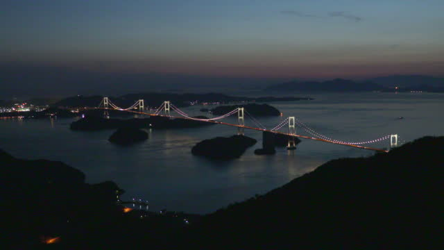 time-lapse, kurushima kaikyo bridge from mt kiro, ehime, japan - suspension bridge stock videos & royalty-free footage