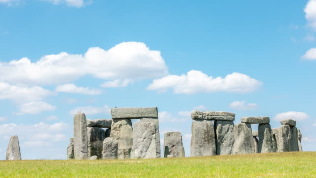 time-lapse: landscape of stonehenge england united kingdom, unesco world heritage site. - stone material stock videos & royalty-free footage