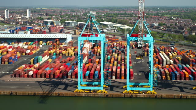 Time-Lapse Large dockside cranes with a brackgound of containers in the Port of Liverpool