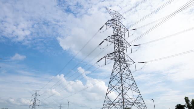 4k timelapse: large high voltage towers - biological process stock videos & royalty-free footage