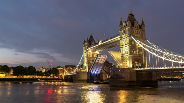time-lapse: lifting of tower bridge in london england uk sunset night - tower bridge stock videos & royalty-free footage