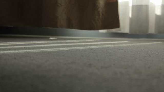 ecu timelapse light of a window in a fitted carpet - teppich stock-videos und b-roll-filmmaterial