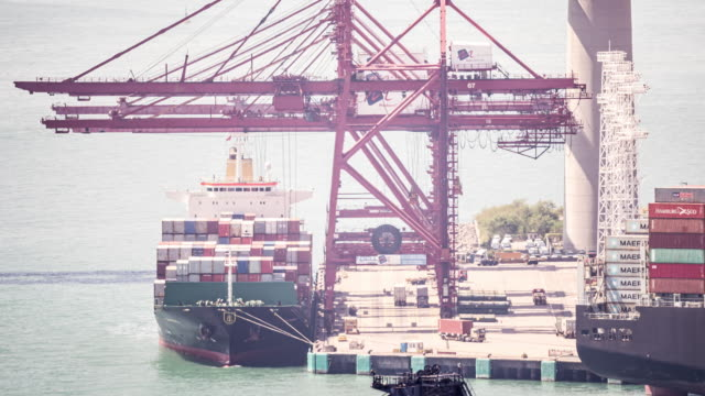time-lapse: loading and unloading container goods to cargo ship at maritime container port tsing yi port of hong kong - unloading stock videos & royalty-free footage