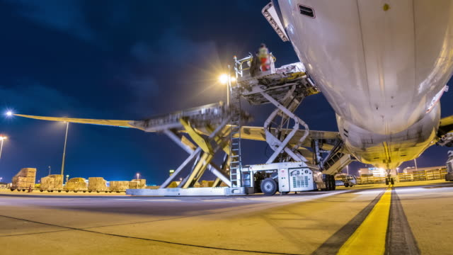 time-lapse: loading cargo aircraft - efficiency stock videos and b-roll footage