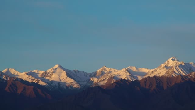 4K ,time-lapse, lockdown; Snow capped mountain at morning in Leh, India.