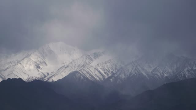 4k ,time-lapse, lockdown; snow storm at himalayas in leh, india. - storm cloud stock videos & royalty-free footage