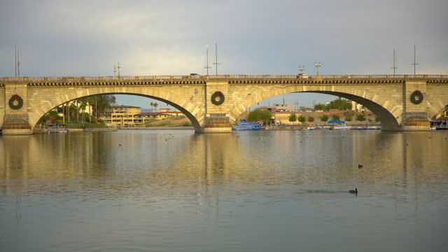 timelapse london bridge relocated from england lake havasu - bridge built structure stock videos & royalty-free footage
