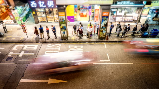 4k timelapse - long queue of people waiting for bus, mong kok - bus stop stock videos & royalty-free footage