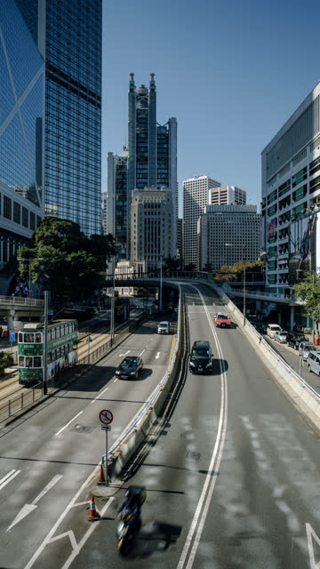 time-lapse looking up queensway road on hong kong island. for vertical displays. - bank of china tower hong kong stock videos & royalty-free footage