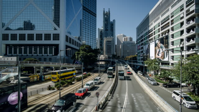 time-lapse looking up queensway road on hong kong island. - bank of china tower hong kong stock videos & royalty-free footage