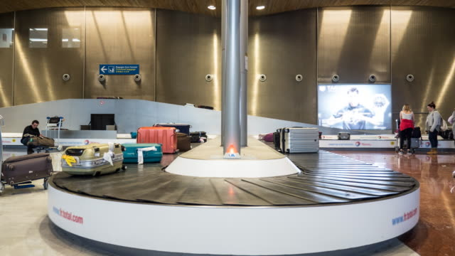 Timelapse luggage on conveyor belt in airport, 4K(UHD)