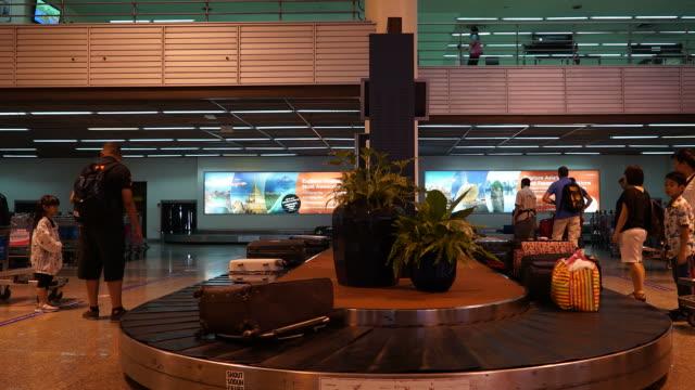Timelapse luggage on conveyor belt in airport