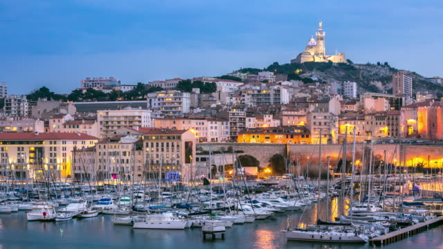 4k time-lapse: marseille city with old vieux port night - notre dame de la garde marseille stock videos and b-roll footage