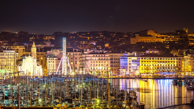 time-lapse: marseille city with old vieux port night - notre dame de la garde marseille stock videos and b-roll footage