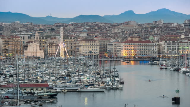 4k time-lapse: marseille city with old vieux port sunset - notre dame de la garde marseille stock videos and b-roll footage