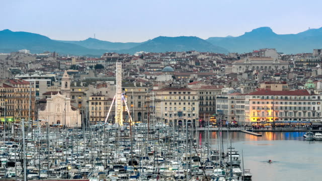 time-lapse: marseille city with old vieux port sunset - notre dame de la garde marseille stock videos and b-roll footage