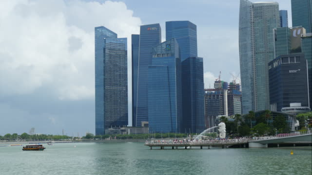 time-lapse merlion at singapore city - merlion fictional character stock videos and b-roll footage