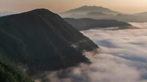 timelapse: mist flowing over lake mashu in akan national park of hokkaido, japan - japan stock videos & royalty-free footage
