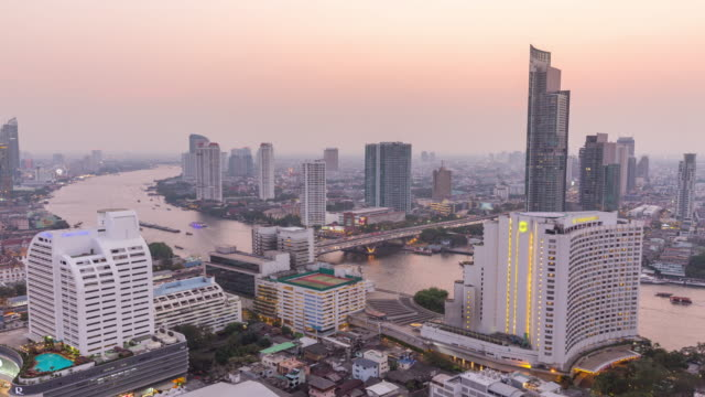 4k time-lapse : modern business building and chao phraya river from day to dusk in bangkok. - day to dusk stock videos & royalty-free footage